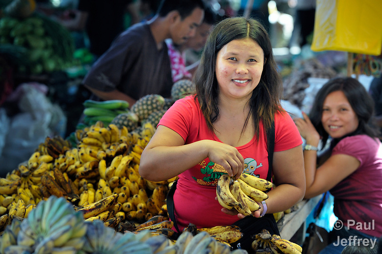 A woman sells bananas in a market in Lupon, a small town on the southern island of Mindanao in the Philippines.