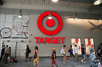Shoppers flock to the new Target store in the East Harlem neighborhood of New York on its opening day, Sunday, July 25, 2010. Target, which is the second largest discount retailer in the United States has opened its first permanent Manhattan location in the East River Plaza, a vertical mall. The company has projected revenue of $90 million in the stores first year of operation (© Richard B. Levine).