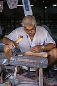 An Artist is seen making wooden blocks at a block printing factory in Jaipur, Rajasthan, India.