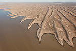 Aerial - Simpson Desert Regional Reserve where amazing lakes litter the sand dunes. Normally dry, the lakes only have water during a very wet season - a very rare occurence.