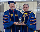 May 18, 2014; University of Notre Dame president Rev. John Jenkins, C.S.C., presents the Laetare Medal to Kenneth R. Miller at the 2014 Commencement ceremony in Notre Dame Stadium.<br /> <br /> Photo by Matt Cashore/University of Notre Dame