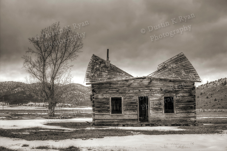 An abandoned log cabin, shack, farm house in the SIerra Nevada Hills