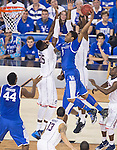 UK guard/forward James Young (1) dunks the ball during the NCAA National Championship vs. UConn at the AT&T in Arlington, Tx., on Monday, April 7, 2014. Photo by Eleanor Hasken | Staff
