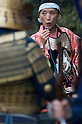 November 3, 2011, Tokyo, Japan - A women who is part of a match lock musketry group blows on a match used to fire her musket at a Martial Arts demonstration held at Meiji shrine to celebrate Japan's National Culture Day. (Photo by Bruce Meyer-Kenny/AFLO) [3692]