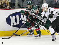 San Antonio Rampage's Greg Rallo, right, fights for the puck with Houston Aeros' Cody Almond, left, and Jeff Penner during the third period of an AHL hockey game, Friday, Dec. 30, 2011, in San Antonio. Houston won 5-2. (Darren Abate/pressphotointl.com)
