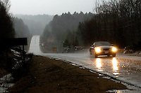 Car driving through a down pour, Algonquin Park, Ontario, Canada