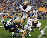 Pittsburgh wide reciever Jonathan Baldwin (82) gets knocked to the ground by Navy cornerback Blake Carter (1) and safety Emmett Merchant (7). The Pittsburgh Panthers defeated the Navy Midshipmen 27-14 at Heinz Field, Pittsburgh, PA.