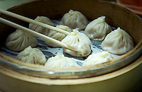 Soup dumplings (xiao long bao) and chopsticks, Taipei.