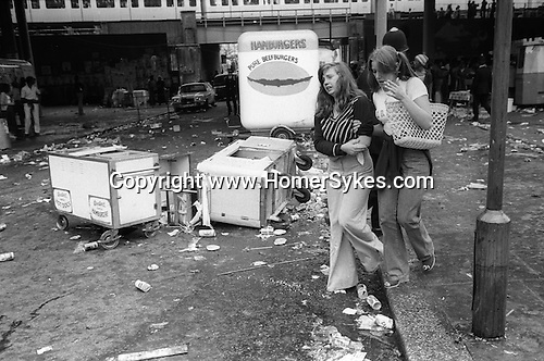 Notting hill Gate Carnival race riot, London W11 England 1976. Young teen girl led away hurt in rioting by friend. Portobello Green this is the north side of the underpass.