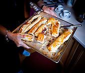 WARSAW, POLAND, NOVEMBER 2011:.Wika Szmyt, 74 year old DJ, holding tray with cakes she just made in her kitched..Wika is famous in Poland for being the oldest DJ. Twice a week she runs discos at the Bolek club in Warsaw, frequented mainly by the pensioners..(Photo by Piotr Malecki/Napo Images)..WARSZAWA, LISTOPAD 2011:.DJ Wika niesie swoje wypieki w domu. Wika Szmyt, 74-letnia DJ jest znana jako najstarsza didzejka w Polsce. Dwa razy w tygodniu prowadzi dyskoteki w klubie Bolek, na ktore przychodza glownie emeryci..Fot: Piotr Malecki/Napo Images.***ZAKAZ PUBLIKACJI W TABLOIDACH I PORTALACH PLOTKARSKICH*** .*** Zdjecie moze byc uzyte w prasie, gdy sposob jego wykorzystania oraz podpis nie obrazaja osob znajdujacych sie na fotografii ***.