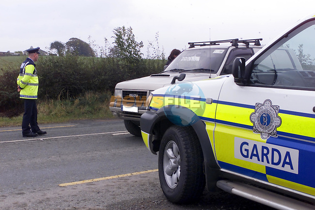 Garda Paul Carragie carrying out a check point on the Morning that the penalty points system was introduced ..Picture Fran Caffrey Newsfile...This Picture is sent to you by:..Newsfile Ltd.The View, Millmount Abbey, Drogheda, Co Louth, Ireland..Tel: +353419871240.Fax: +353419871260.GSM: +353862500958.ISDN: +353419871010.email: pictures@newsfile.ie.www.newsfile.ie