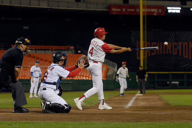 GOP coach Mike Oxley bats at the 45th Annual Roll Call Congressional Baseball Game at RFK stadium.