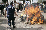 A Mexican anti-drug policeman burn marijuana packets as journalists look on at La Palma Police Academy facility in Mexico State, November 23, 2007. Around 250 kgs of marijuana were conficasted during a police raid in Villa Guerrero municipality. Photo by Javier Rodriguez