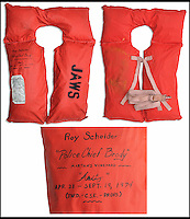 BNPS.co.uk (01202 558833)<br /> Pic: NateDSaunders/BNPS<br /> <br /> ***Please use full byline***<br /> <br /> Actor Roy Scheider's life jacket. <br /> <br /> Rare behind-the-scenes photographs taken on the set of the cult movie 'Jaws' has surfaced after 40 years.<br /> <br /> The 75 pictures include ones of star Roy Scheider, who played shark-hunting police chief Brody in the classic 1975 film, and director Steven Spielberg.<br /> <br /> There are several snaps of the giant mechanical rubber shark that wreaked terror on the fictional seaside resort of Amity.<br /> <br /> It is depicted being hoisted in the air and moved into position as well as sat in a dry dock during a break in the filming.