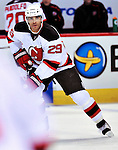 9 January 2010: New Jersey Devils' defenseman Johnny Oduya warms up prior to a game against the Montreal Canadiens at the Bell Centre in Montreal, Quebec, Canada. The Devils edged out the Canadiens 2-1 in overtime. Mandatory Credit: Ed Wolfstein Photo