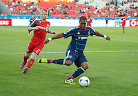 12 September 2012:  Chicago Fire forward Sherjill MacDonald #7 and Toronto FC defender Richard Eckersley #27 in action during an MLS game between the Chicago Fire and Toronto FC at BMO Field in Toronto, Ontario..The Chicago Fire won 2-1..