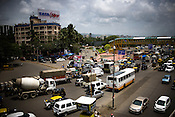 A TATA Sky billboard is seen against the background of traffic in Mumbai, India.