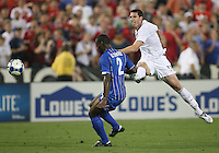 Kenny Cooper #17 of the USA blasts a shot past Osman Chavez #2 of Honduras during a CONCACAF Gold Cup match at RFK Stadium on July 8 2009 in Washington D.C.