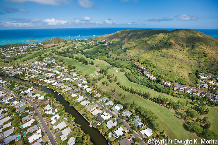 Bluestone Condominiums - aerial view of the full length of the development. Bluestone community line the hillside overlooking the 16th, 17th, and 18th holes of the Mid-Pacific Country Club. The community and golf course end at the clubhouse which is a short walk to Lanikai Beach.