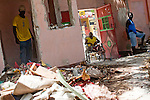 Men clean rubble out of a former school on July 7, 2010 in Port-au-Prince, Haiti.