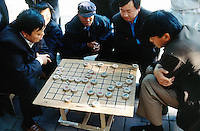 "China. Province of Beijing. Beijing. Men play in the street the traditional chinese chess game, "" majong"".  © 2004 Didier Ruef"