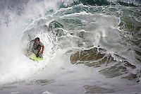 20 June 2006:  Body boarder JJ Ayala rides a Single set wave on one knee during a South swell reaches the famous surf spot in Newport Beach, CA called The Wedge.  Surfers, boogie boarders, body surfers and crowds gather to watch the powerful waves and the waters take shape into unique sets along the jetty in Orange County, California.  Sequence of photos.