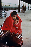 A brother and sister wait on the platform for the train to arrive at the Rawalpindi train station, Pakistan, 1984.<br />