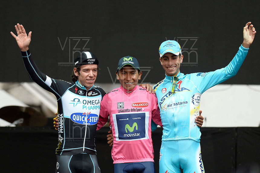 ITALIA. 01-06-2014. Nairo Alexander  Quintana Rojas -Col- (Movistar) celebra como campe&oacute;n general de la versi&oacute;n 97 del Giro de Italia hoy 22 de mayo de 2014. A su izquierda Rigoberto Ur&aacute;n subcampe&oacute;n y Fabio Aru a su derecha tercero. / Nairo Alexander  Quintana Rojas -Col- (Movistar)celebrates as champion of the 97th version of Giro d'Italia today May 22th 2014. At his left Rigoberto Uran second and Fabio Aru third in the standings.  Photo: VizzorImage/ Fabio Ferrari / LaPresse<br /> VizzorImage PROVIDES THE ACCESS TO THIS PHOTOGRAPH ONLY AS A PRESS AND EDITORIAL SERVICE AND NOT IS THE OWNER OF COPYRIGHT; ANOTHER USE HAVE ADDITIONAL PERMITS AND IS  REPONSABILITY OF THE END USER