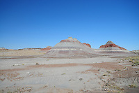 Navajo County, Arizona – These geological formations are known as The Teepees of the Painted Desert.  The area is within the Petrified Forest National Park. The Painted Desert is a broad region of rocky badlands featuring unique rocks in a variety of hues - lavenders, grays, reds, oranges and pinks. Located in Northeastern Arizona, the Painted Desert attracts hundreds of thousands a visitors each year. Photo by Eduardo Barraza © 2014