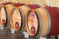 Fermentation in barrel. Oak barrel aging and fermentation cellar. Vinification integrale. Chateau Malartic Lagraviere, Pessac Leognan, Graves, Bordeaux, France