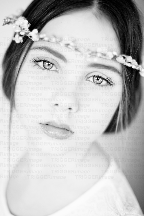 Young girl wearing headband with sparkling eyes