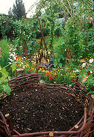 Composted Materials in Woven Bin in Garden