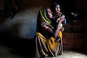 Ramdevi Barskar poses for a portrait with her 18 month daughter, Kanchan in her hut in village in Lalitpur district of Uttar Pradesh, India. Kanchan was a malnutritioned child and spent some time at the Nutritional Rehabilitation Centre in a hospital in Talbehat. The Indian government spends $1.4 billion a year - on programs that include weighing newborn babies, counseling mothers on healthy eating and supplementing meals, but none of this is yeilding results. According to UNICEF, some 48% of Indian children, or 61 million kids, remain malnourished, the clinical condition of being so undernourished that their physical and mental growth are stunted. Photo: Sanjit Das/Panos for The Wall Street Journal.Slug: IMALNUT