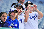 23 April 2010: Los Angeles Dodger fans take pictures of batting practice prior to a game against the Washington Nationals at Nationals Park in Washington, DC. The Nationals defeated the Dodgers 5-1 in the first game of their 3-game series. Mandatory Credit: Ed Wolfstein Photo