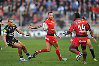 Quade Cooper of Toulon passes the ball. European Rugby Champions Cup match, between RC Toulon and Bath Rugby on January 10, 2016 at the Stade Mayol in Toulon, France. Photo by: Patrick Khachfe / Onside Images
