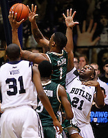 INDIANAPOLIS, IN - FEBRUARY 13: Darion Clark #1 of the Charlotte 49ers shoots the ball as Roosevelt Jones #21 of the Butler Bulldogs defends at Hinkle Fieldhouse on February 13, 2013 in Indianapolis, Indiana. Charlotte defeated Butler 71-67. (Photo by Michael Hickey/Getty Images) *** Local Caption *** Darion Clark; Roosevelt Jones