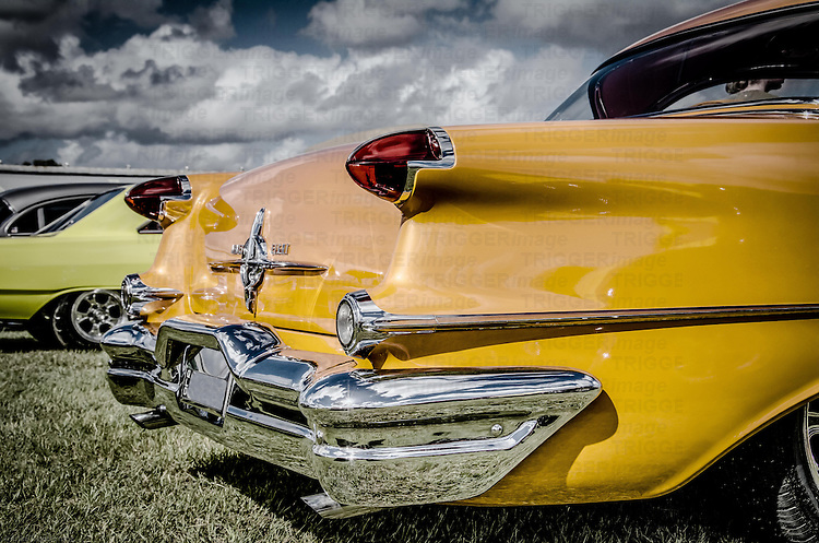 Classic American muscle car in yellow with chrome fender