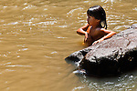 Mbya Guarani children from aldea Katupyry near San Ignacio, Misiones, Argentina, swimming in the Rio Cazador where it passes through their property.