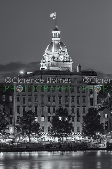 The lights of River Street and gold domed City Hall on the Savannah River at twilight in Savannah, Georgia