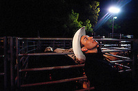Professional bull rider Scott Barajas, 19, of Cheyenne, demostrates the up-facing riding position of his good friend Bryan Guthrie at a small arena behind the Stampede Steakhouse in Fort Collins, Colo. Nationally ranked professional bull rider Bryan Guthrie often rode in the small local series. Guthrie died of an overdose of heroine last December. His former friend Joel Murdoch faces sentencing in June for conspiracy to distribute drugs. (Kevin Moloney for the New York Times)