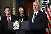 United States Vice President Mike Pence delivers remarks during the swearing in ceremony for Nikki Haley (C) as the U.S. Ambassador to the United Nations January 25, 2017 in Washington, DC. Haley was formerly the Governor of South Carolina. Also pictured is US Senator Marco Rubio (Republican of Florida). <br /> Credit: Win McNamee / Pool via CNP