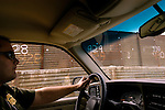 U.S. Border Patrol Agent Kurstan Rosberg drives along the U.S./Mexico border near San Ysidro, Calif. on Monday, March 28, 2005.<br />