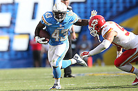 San Diego Chargers running back Branden Oliver #43 and Kansas City Chiefs inside linebacker Josh Mauga #90 during an NFL game played at Qualcomm Stadium in San Diego, CA on Sunday October 19, 2014. (AP Photo/Michael Zito)