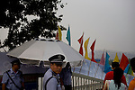 Police officers keep a close eye on foot traffic on an overpass new the Olympic Games venues in Beijing, China on Monday, August 4, 2008. The city of Beijing is gearing up for the opening ceremonies of the Olympic Games.  Kevin German