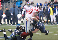 Seattle Seahawks #27 Jordan Babineaux  and #51 Lofa Tatupu brings down New York Giants tight end Jeremy Shockey during the third quarter at Quest Field in Seattle, WA.