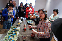 Beatrice Lei Chang (2nd-R) shows pieces of art at her gallery during the Asian Art Week in New York. 11.03.2015. Eduardo MunozAlvarez/VIEWpress.