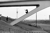 Playing on the bridge, Wester Hailes, Scotland, 1979.  John Walmsley was Photographer in Residence at the Education Centre for three weeks in 1979.  The Education Centre was, at the time, Scotland's largest purpose built community High School open all day every day for all ages from primary to adults.  The town of Wester Hailes, a few miles to the south west of Edinburgh, was built in the early 1970s mostly of blocks of flats and high rises.