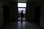 Rev. Bob Walter looks out a hallway hospital window on the 5th floor of SFGH.