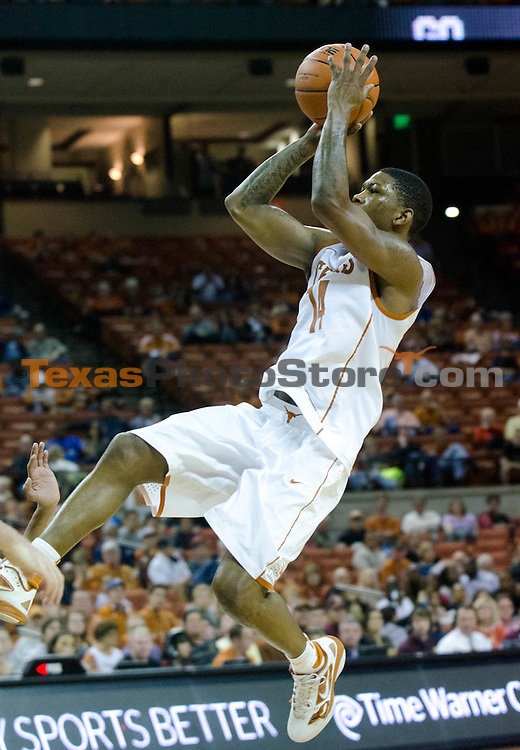 Dec 15, 2012; Austin, TX, USA; Texas Longhorns guard Julien Lewis (14) shoots against the Texas State Bobcats during the second half at the Frank Erwin Special Events Center. Texas beat Texas State 75-63. Mandatory Credit: Brendan Maloney-USA TODAY Sports