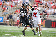 College Park, MD - May 14, 2017: Maryland Terrapins Isaiah Davis-Allen (26) hits Bryant Bulldogs Brett Baker (21)during the NCAA first round game between Bryant and Maryland at  Capital One Field at Maryland Stadium in College Park, MD.  (Photo by Elliott Brown/Media Images International)